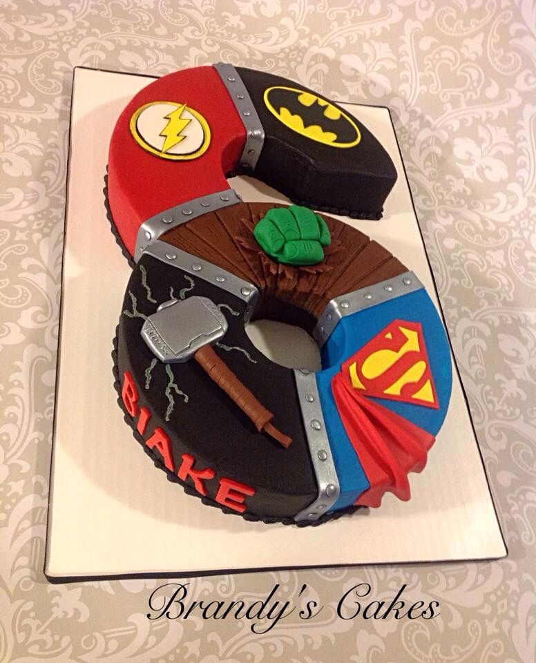 Marvel and DC superhero birthday cake in buttercream with fondant