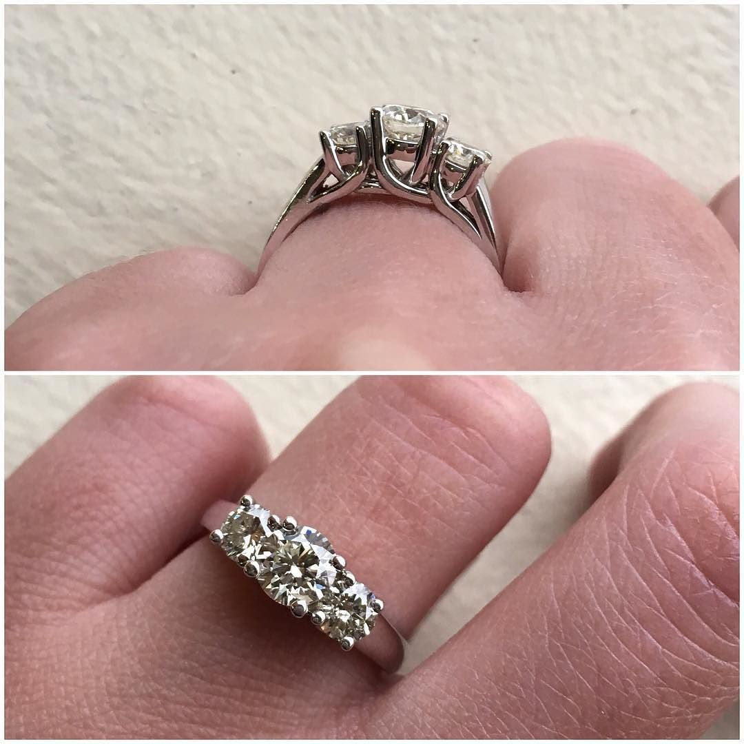 A classic three stone ring with a .65 carat center and .60 ctw side ...