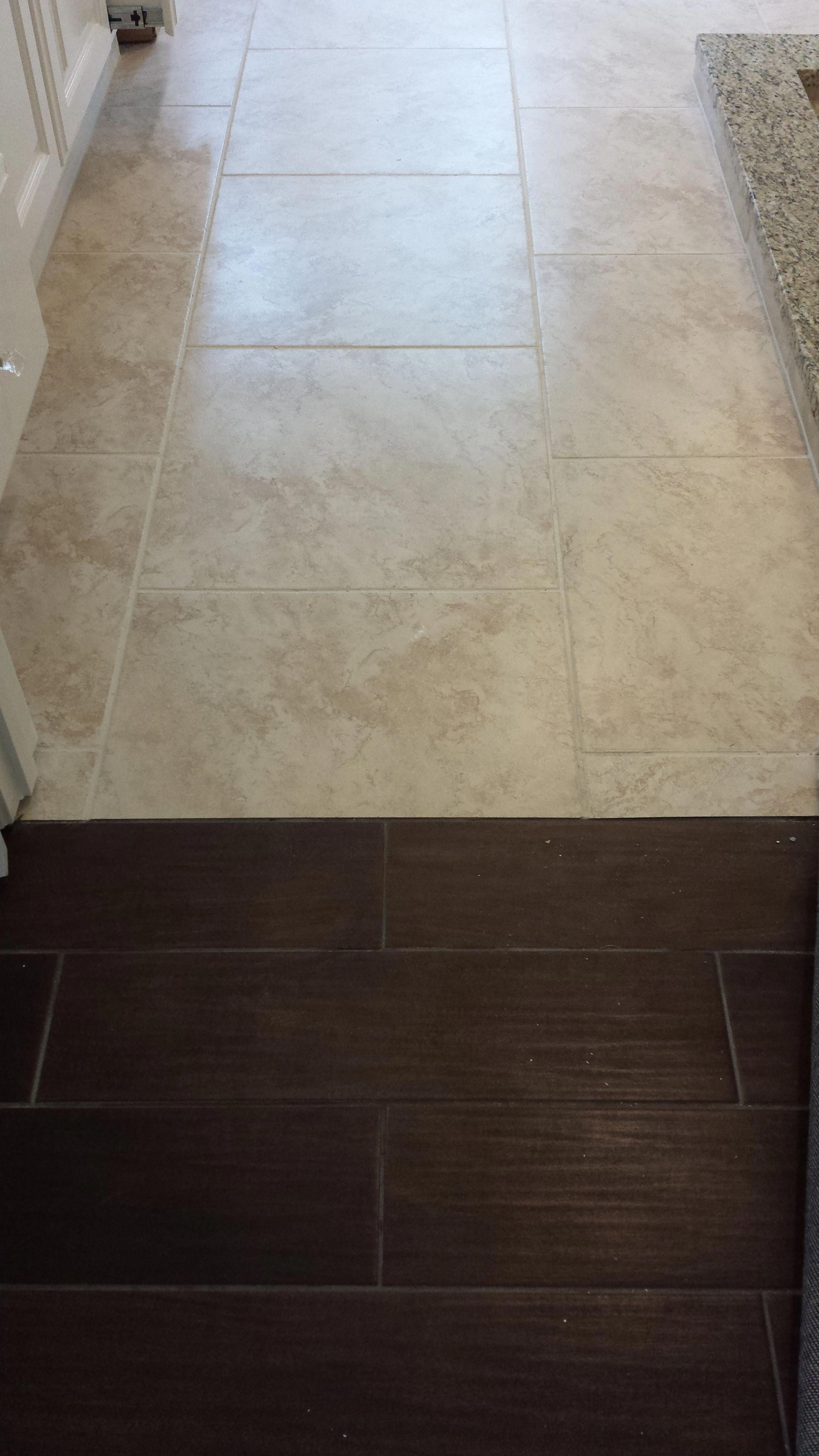 Nice transition from porcelain floor that looks like wood in the