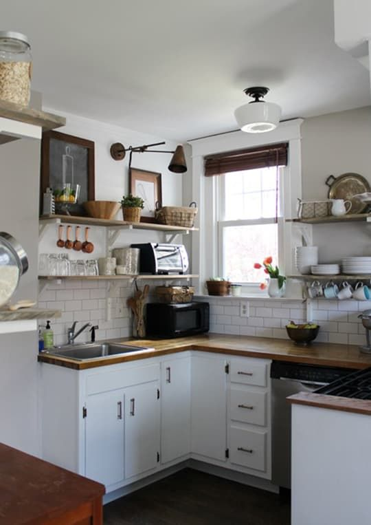 Dream kitchen renovations are fun to see and all, but it's the DIY pull-them-up-by-their-bootstrap remodels that really hold onto our hearts. Ranging in cost from $2,000 to $4,000, these kitchens show what happens when owners don't let small budgets get in the way of big improvements.