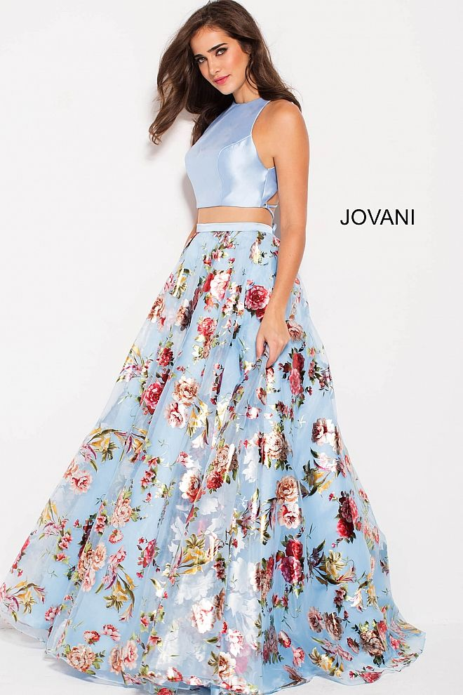 cb5009f7ef8 Floor length A line two piece blue prom ballgown features multi color floral  print skirt and sleeveless and backless high neck crop top.  Jovani   PromDress ...