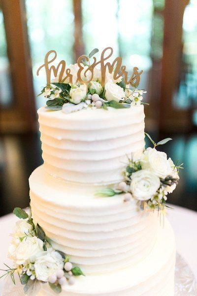 Classic Wedding Cake Idea Two Tier Buttercream Frosted Wedding Cake With Greenery And Wh Classic Wedding Cake Simple Wedding Cake Wedding Cakes With Flowers