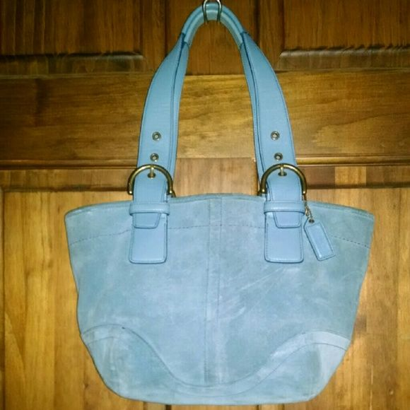 "Coach Baby Blue Suede Tote hobo Bag Coach Baby Blue Suede Tote hobo Bag  Twin baby blue leather adjustable straps held with 2 brass buckles on each side Baby blue leather Coach Tag Nice beautiful stitched patches of baby blue suede with shapely bottom Top zipper closure Interior Zipped pocket 2 Slip pockets  Coach No. K3S-9522  Approx. Measurements Length Bottom 9"" Length 12"" Height 9"" Wide 5""  Strap Drop 9"" Adjustable Gently used Coach Bags Totes"