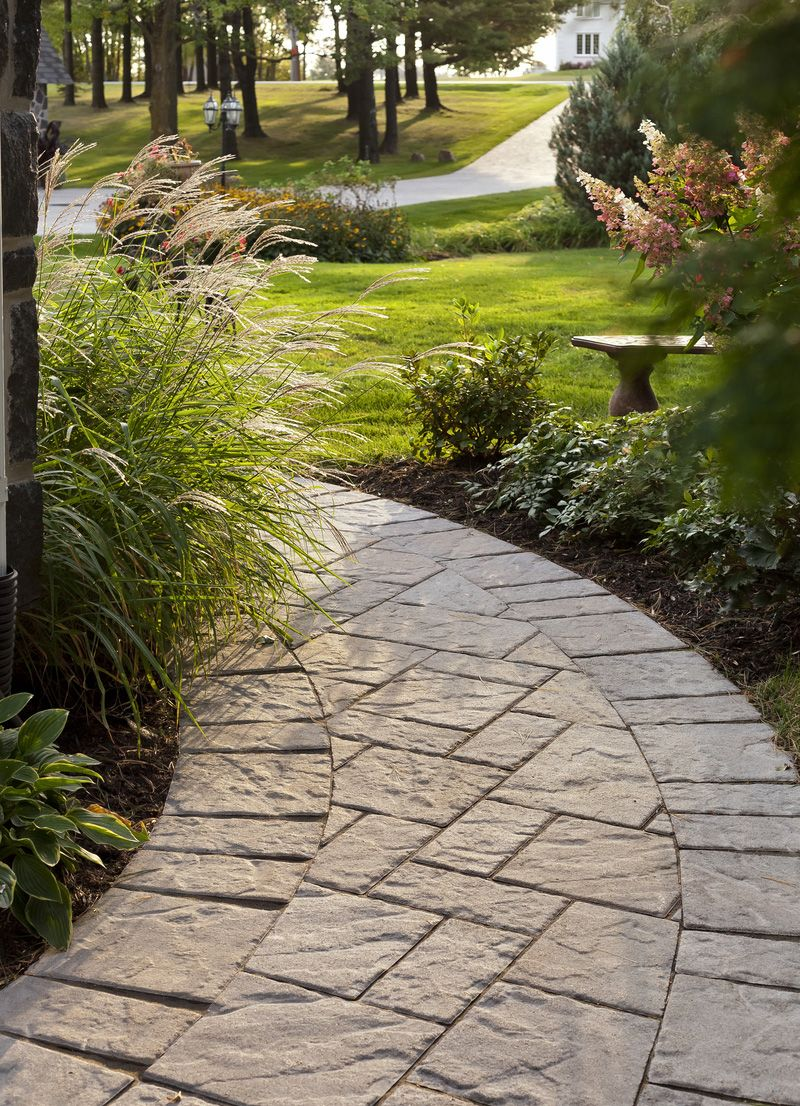 Curved walkway and edging with techo bloc blu stone for Walkway edging ideas