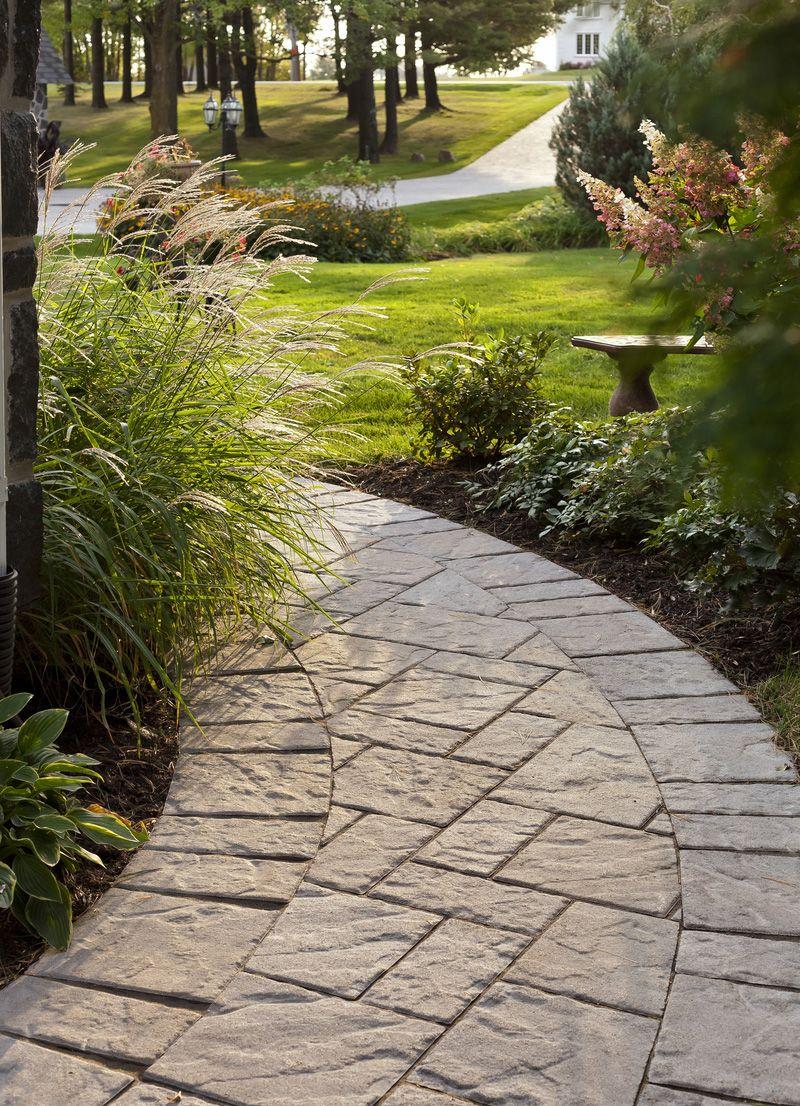 Curved Walkway And Edging With Techo Bloc Blu Stone Pavers Flagstone Walkway Walkway Landscaping Front Yard Walkway