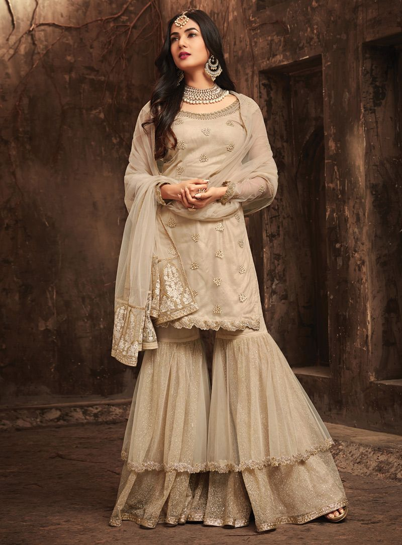 22b6154074 Buy Sonal Chauhan Beige Net Sharara Style Suit 133746 online at lowest  price from huge collection of salwar kameez at Indianclothstore.com.
