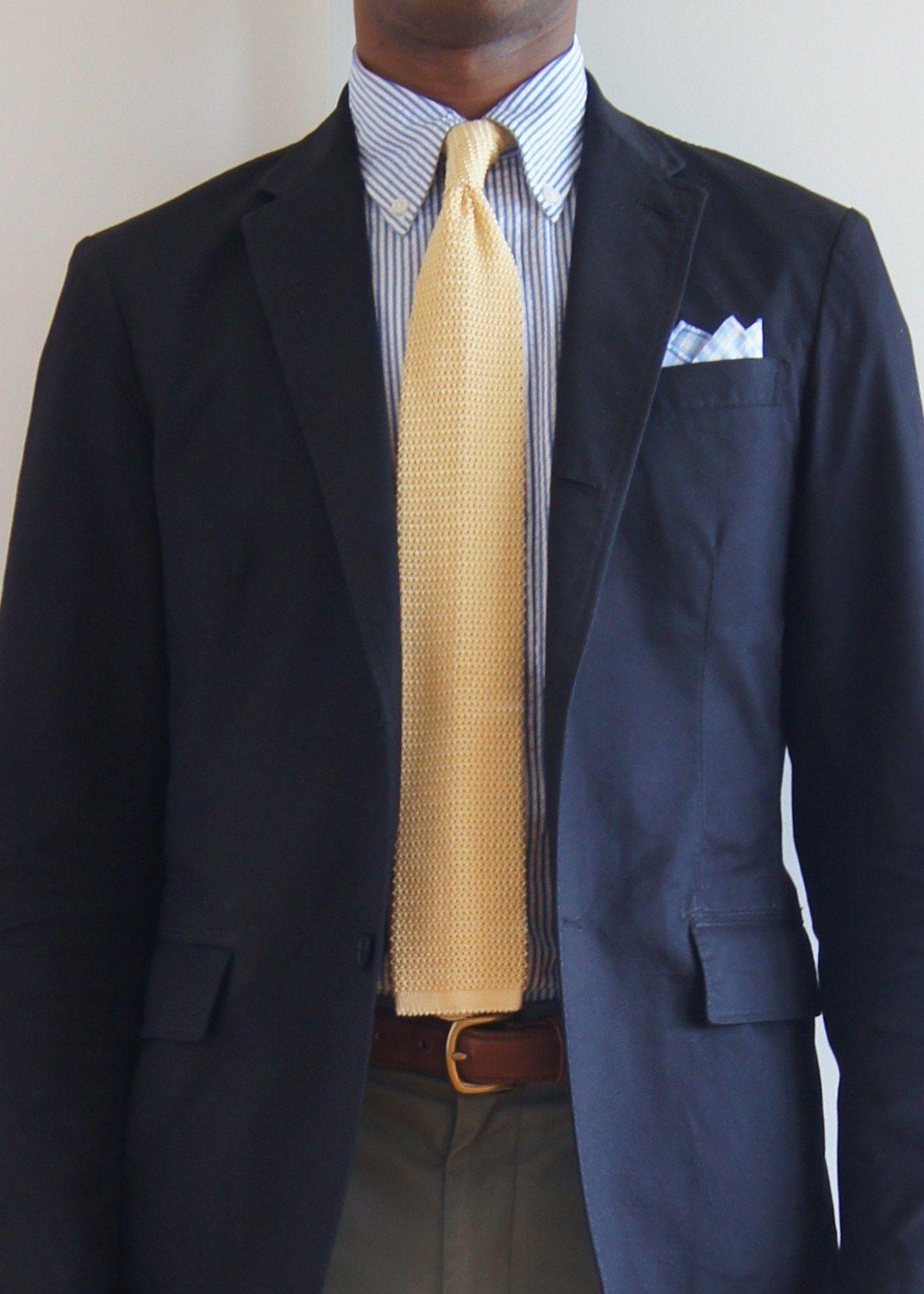 Navy sport coat, white shirt with light blue dress stripes
