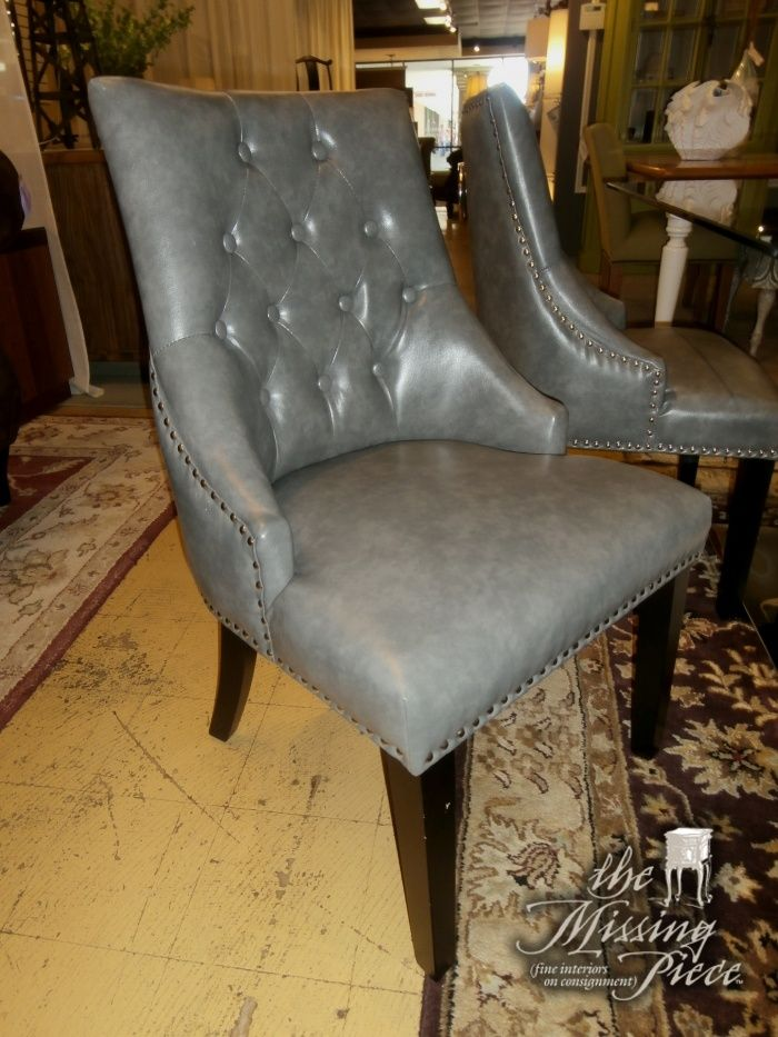 Set of four (4), sloped arm dining chairs with silver nail head trim and sterling loop on the back of each chair. Adorable.
