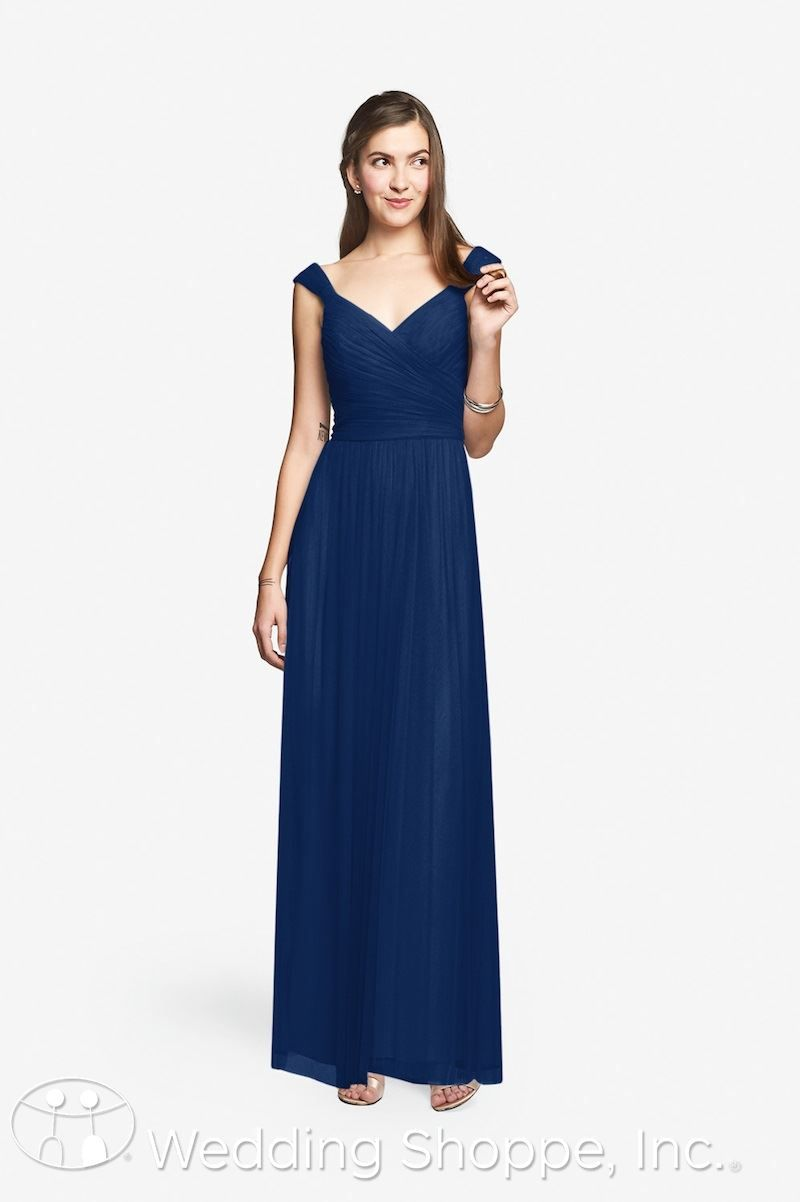 A beautiful and classic tulle bridesmaid dress in cobalt blue.
