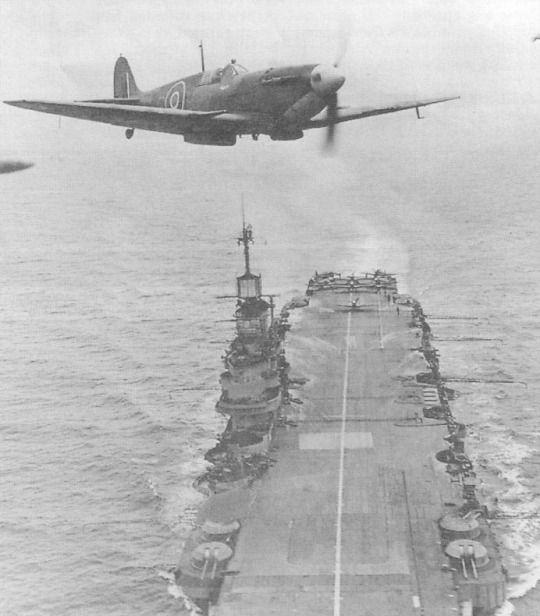 Supermarine Seafire passing over HMS Indomitable