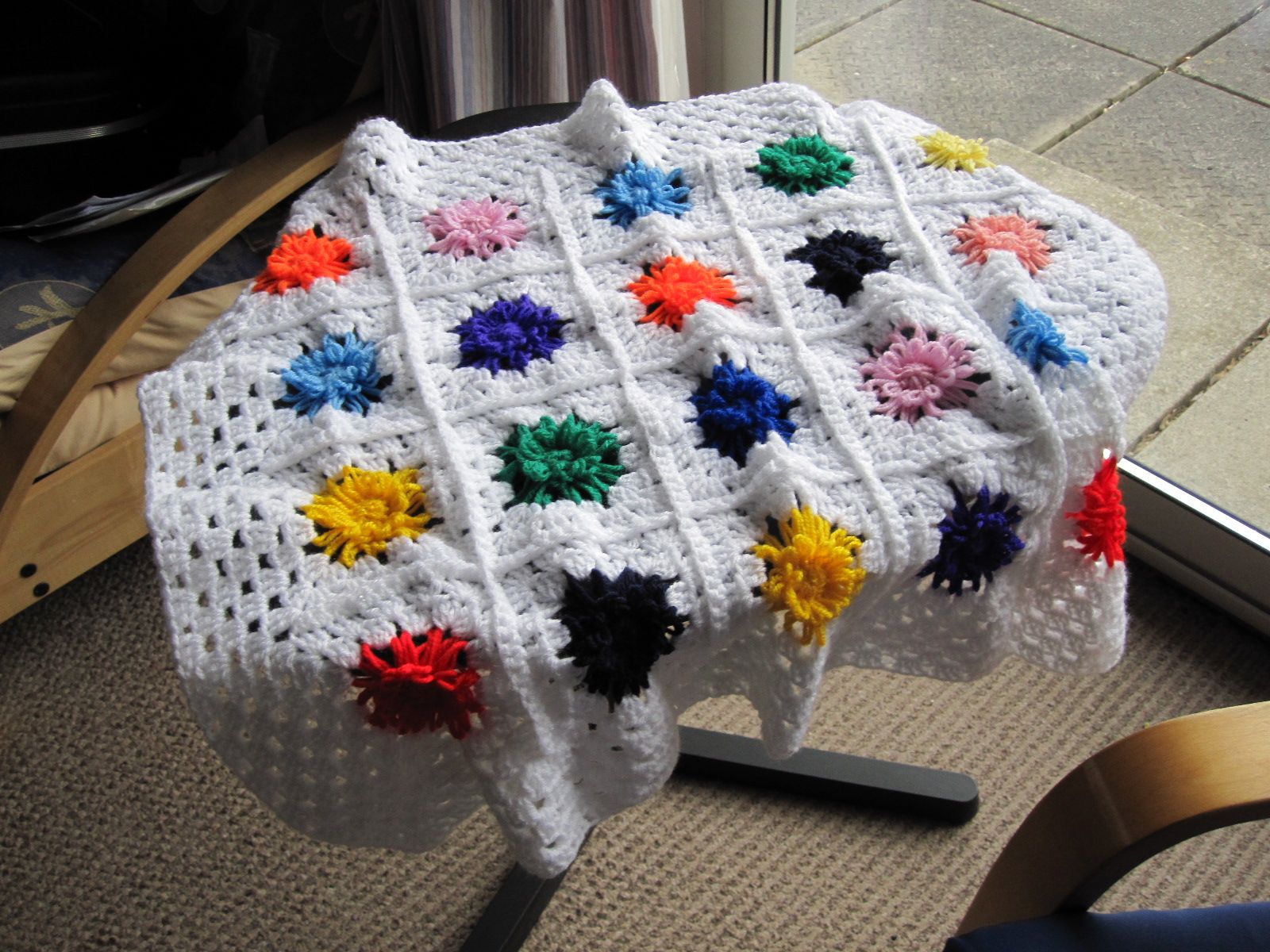 Hand crochet white with flowers baby blanket or pram rug available at www.woollygoods.com