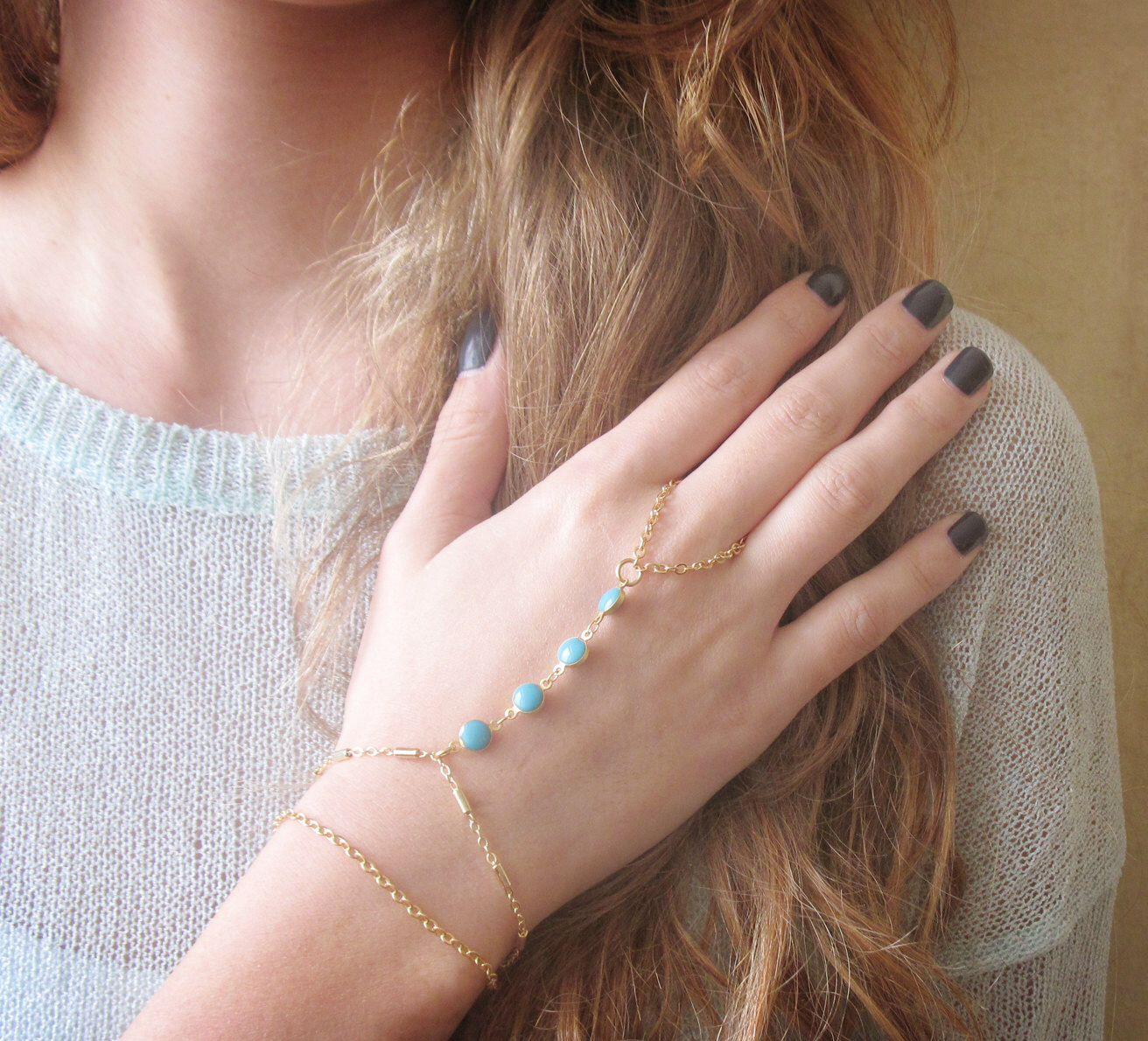 Hand Chain Bracelet - Gold Slave Bracelet - Ring Bracelet - Harem bracelet - Belly Dancers Bracelet - Gold Finger Bracelet - Slave Ring by baronykajd on Etsy https://www.etsy.com/listing/216044289/hand-chain-bracelet-gold-slave-bracelet