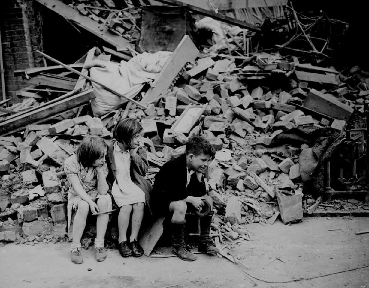 East London Children Outside The Rubble Of Their Home Trying To