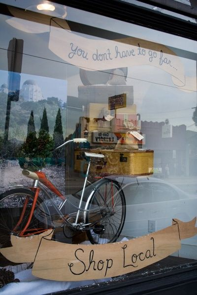 If you are a non-retail business with great display windows, take advantage! Decorate for seasons, holidays, organizations, or special causes like shopping locally! (Reform School shop window by Jessica Pezalla of Bramble Workshop)