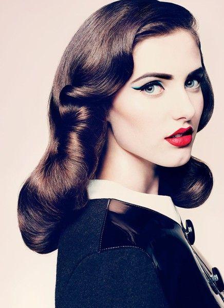 lovely modern take on vintage hair and make up. love the dash of blue eye-liner!