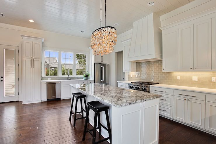 White Kitchen Cabinets With Granite Countertops gorgeous kitchen features white cabinets paired with white quartz