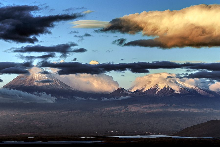 Sunrise at Kliuchevskoi and Ushkovsky volcanoes in Kamchatka, as seen from Shiveluch volcano. In the foreground Klyuchi village and Kamchatka river.    More Kamchatka photos on my website:  www.xflo.net/en/?p=1716