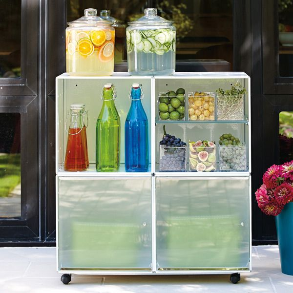 Create a mobile drink station by stacking four of our QBO® Steel Cubes on our Caster Base. Store garnishes and sparkling water below. Serve lemonade or cucumber water from our Glass Canisters.