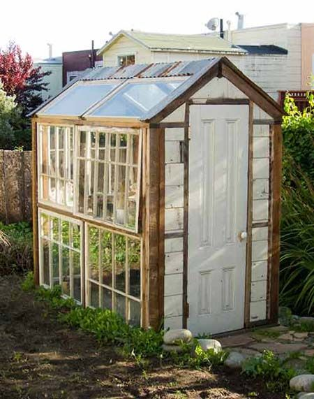 Greenhouse from recycled windows gardening pinterest for Reclaimed window greenhouse