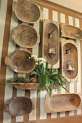 Old Dough Bowls...on the wall.  This looks cool, but I want a few of these to for a great table centerpiece, or a cook way to hold baubles and such.