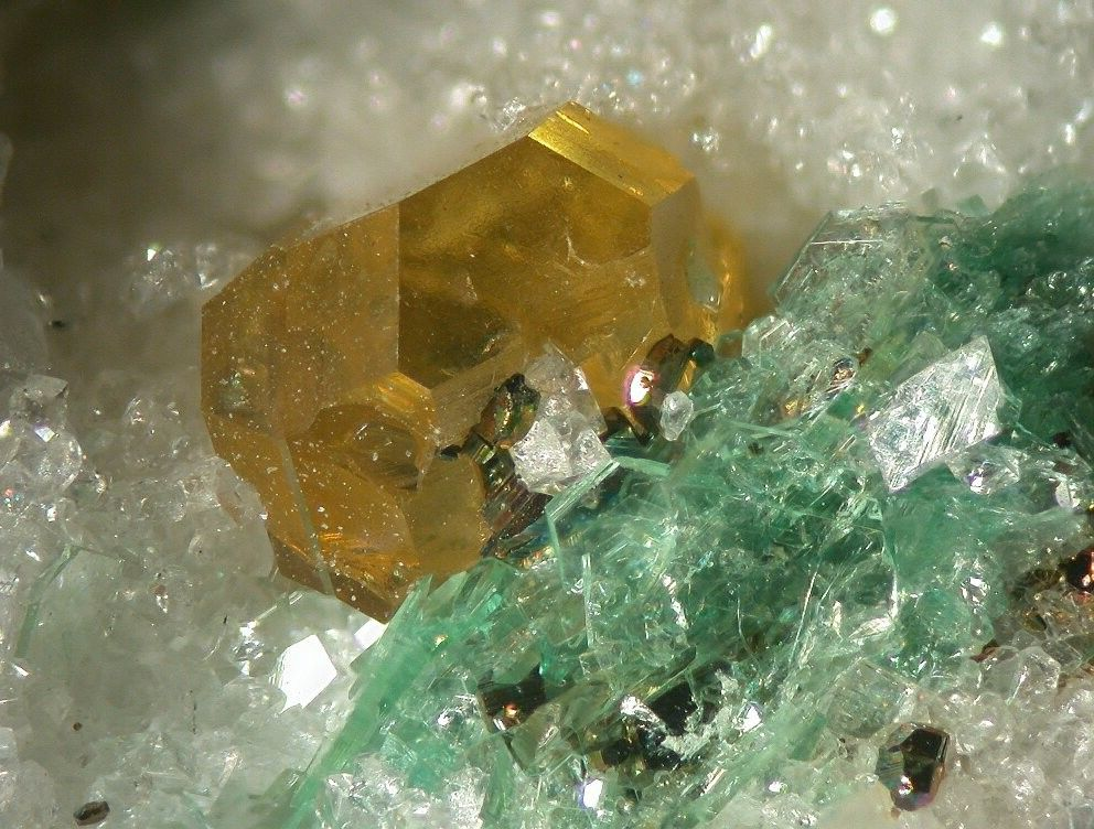 Muscovite (Var: Barian Muscovite),  (K,Ba)(Al,Mg)2(AlSi3O10)(OH)2, with Sphalerite and Pyrite, Lengenbach Quarry, Fäld, Binn Valley, Wallis, Switzerland. Fov 6mm. Green Barian Muscovite (also called 'Oellacherite') with a nice yellow crystal of Sphalerite and minor Pyrite. Copyright © Elmar Lackner 2007