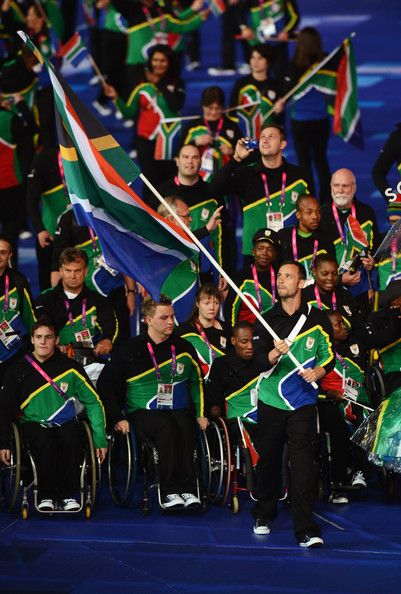 Athlete Oscar Pistorius of South Africa carries the flag during the Opening Ceremony of the London 2012 Paralympics at the Olympic Stadium on August 29, 2012