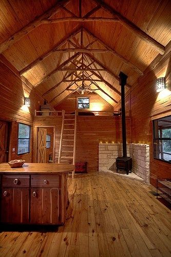 The wood burning stove and central heat warm up the cabin for Small log cabin interior design ideas