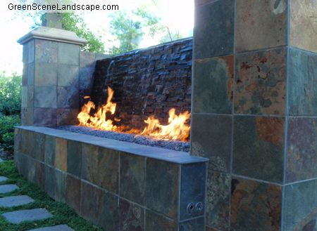 So cool waterfall and fire pit in one for the yard for Fire and water features