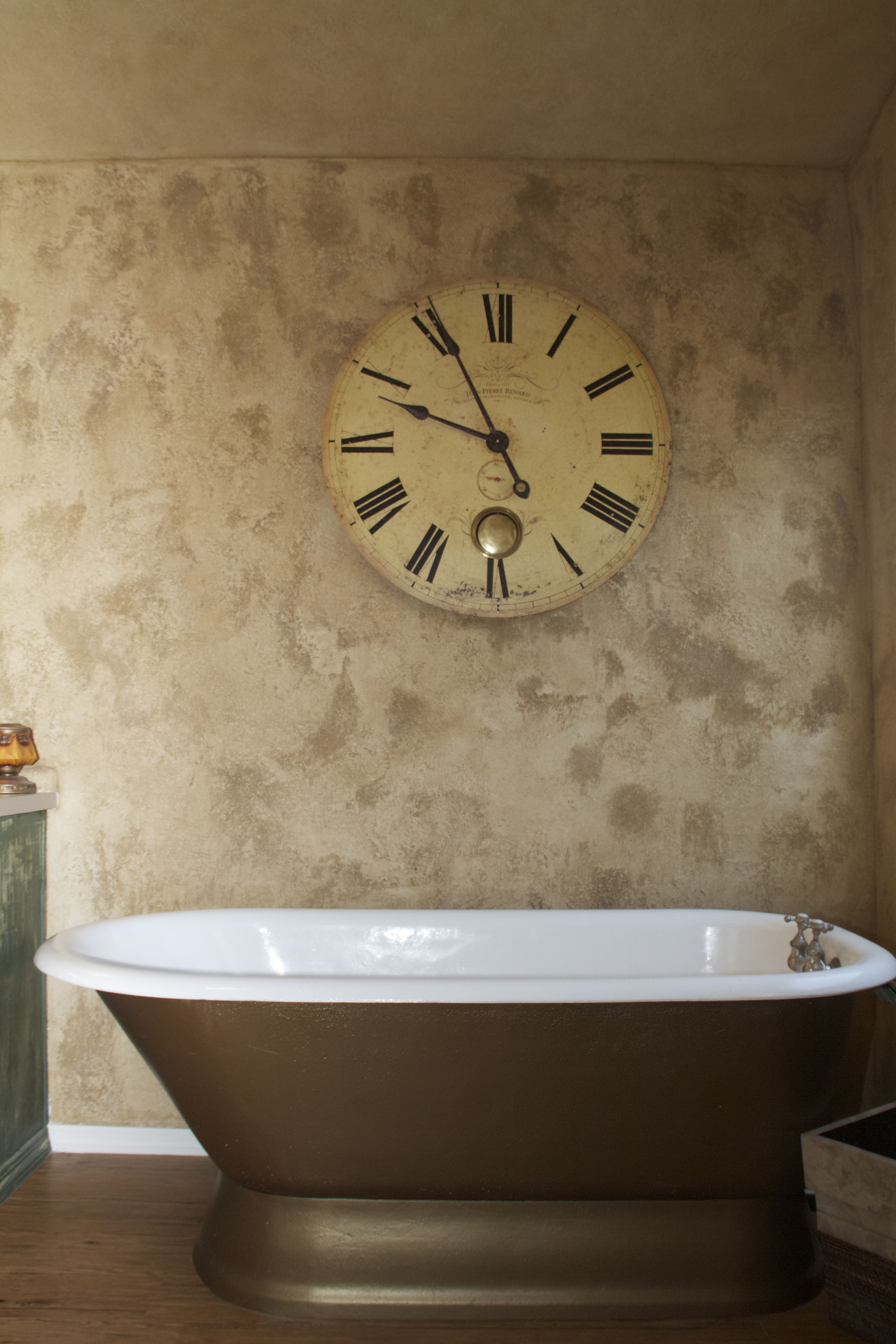 Bathroom Wall With Heavy Plaster And Old Cast Iron Tub