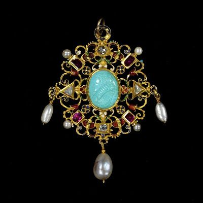 "The Wild Jewel, 1590.  Known as ""The Wild Jewel,"" this pendant jewel in gold and enamel is set with diamonds and rubies and encloses a turquoise cameo of Queen Elizabeth I.  It is hung with pearls."