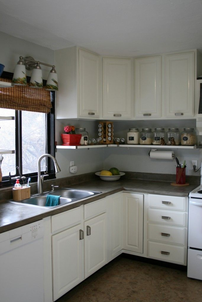 Raised cabinets to the ceiling Allows space for an open
