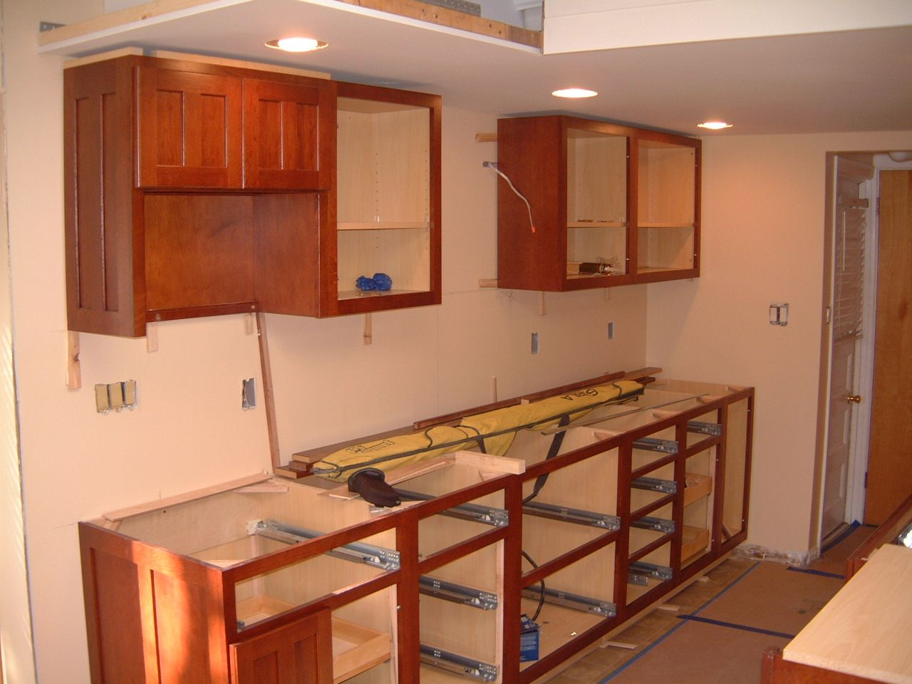 The Base And Upper Cabinets Have Been Installed Sink Wall You Back Entrancing Kitchen Cabinet Cost Review
