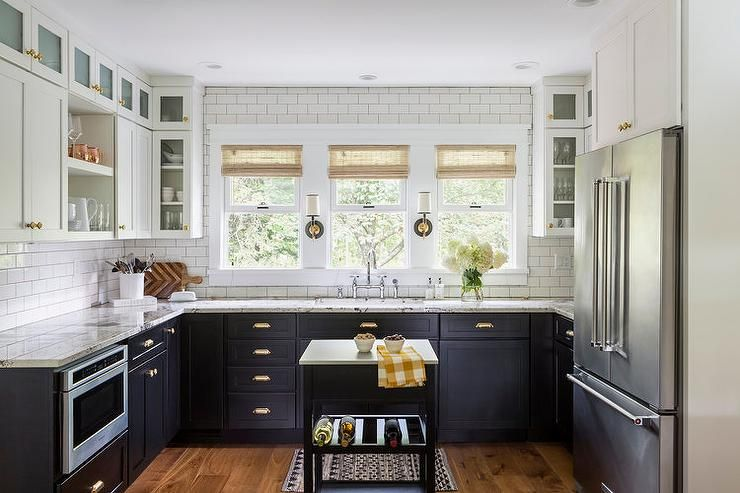 One Trend In Kitchen Design Is To Mix Cabinet Finishes, Using Contrast To  Draw Special