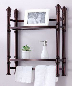 Create more space in an unexpected place with this stylish space-saver shelf that creates storage over the commode. Two sturdy shelves and an elegant finish offer a rich, classic look and ensure that the powder room stays pristinely organized.
