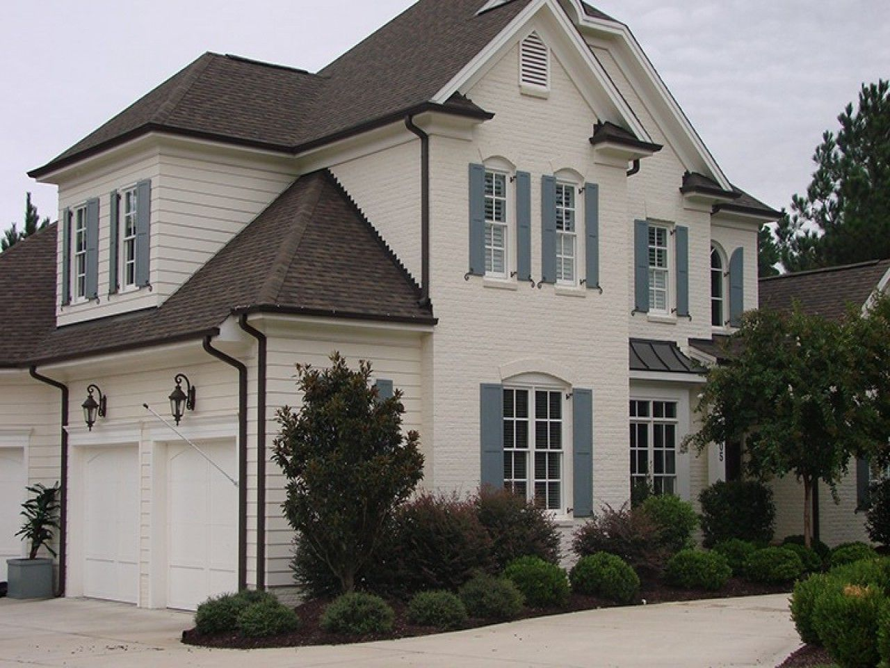 Ivory Exterior Pale Blue Gray Shutters Bronze Trim Perfect Update For A Little Cottag House Exterior Blue Exterior Paint Colors For House White Brick Houses