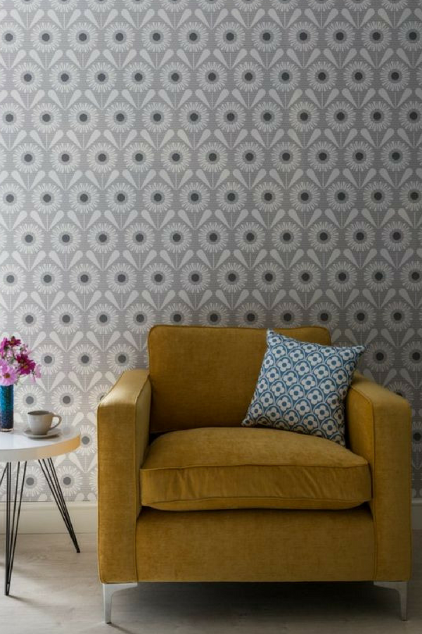 Sunny Flower, Wallpaper, LF1063 is part of Home Accessories Design Fun - A fun and vibrant wallpaper design, featuring a repeated motif of a stylised flower, with a grey centre  Shown here in the soft grey colourway  Other colourways are available  Please request a sample for a true colour match