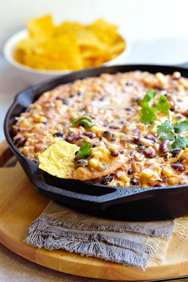 Hot Mexican Bean Dip - an easy appetizer idea that can be made and served in a cast iron skillet. G