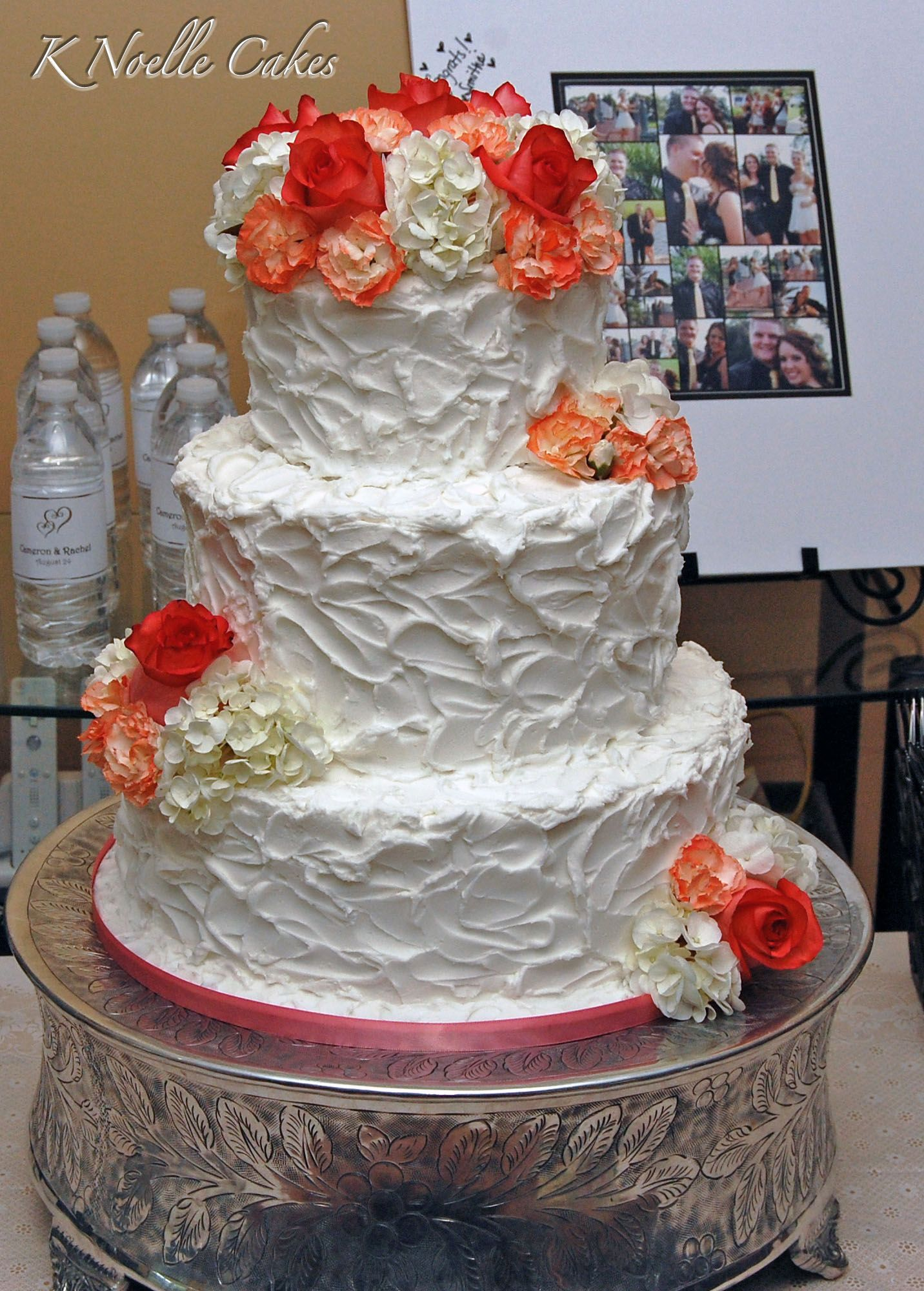 Floral themed wedding cake by K Noelle Cakes