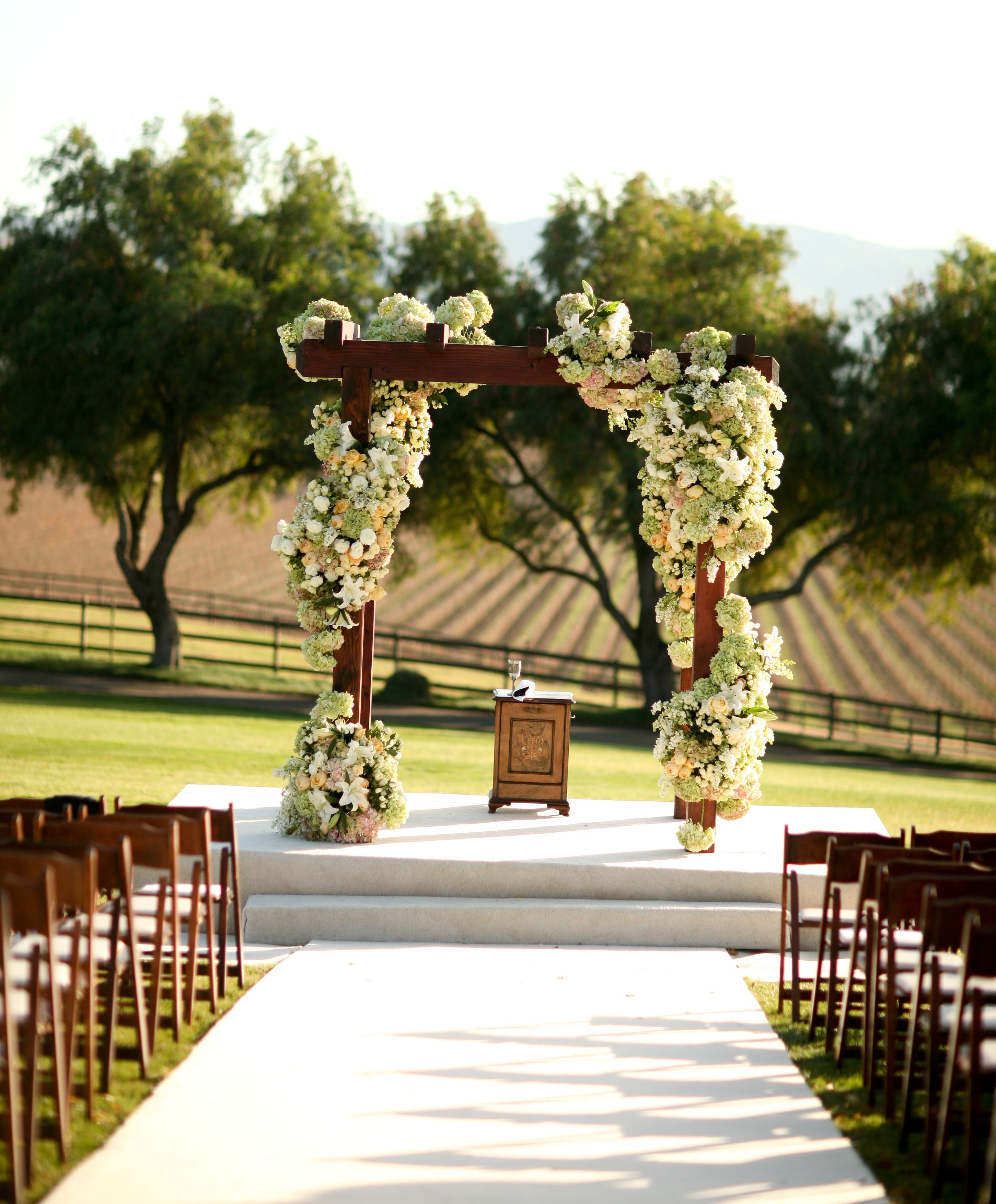 Wedding Altar Decorations Budget: Voluptuous Cascade Of White And Cream Flowers Twining