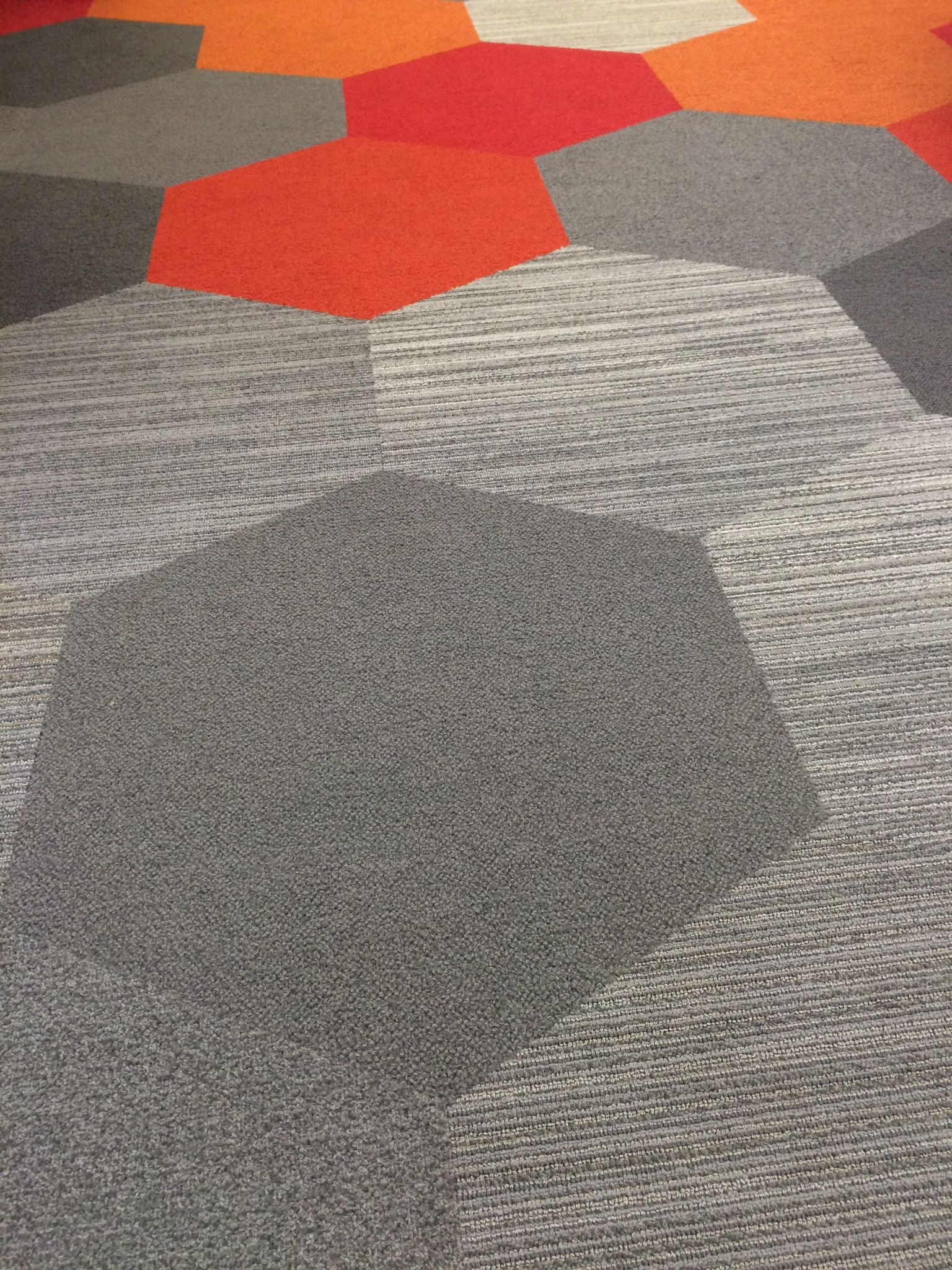 Installation Of Hexagon Plane And Linear Carpet Tiles