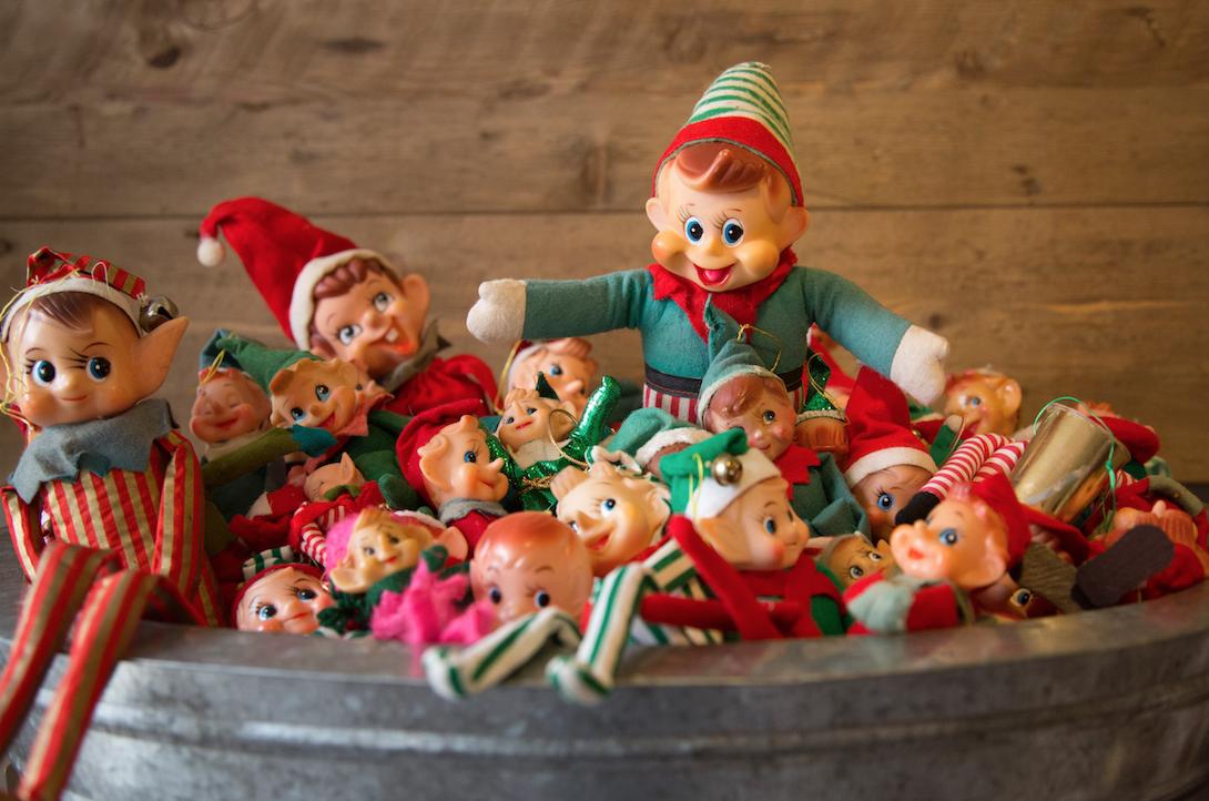 A bucket full of elf on the shelf.