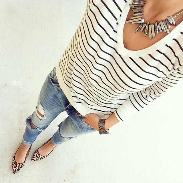 Black and white striped v-neck sweater with a statement necklace, destructed denim, and leopard flats - casual fall outfit