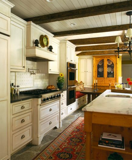 Heated Stone Floors Custom Cabinets And Hand Hewn Beams Make This New Kitchen A Warm And Functional Space Rustic Ceiling Beams Ceiling Beams Kitchen Ceiling