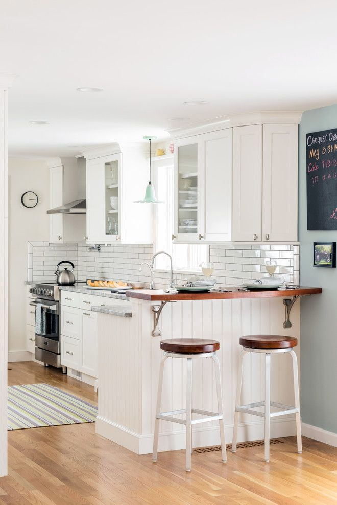 White kitchen, subway tile backsplash, shiplap island ...