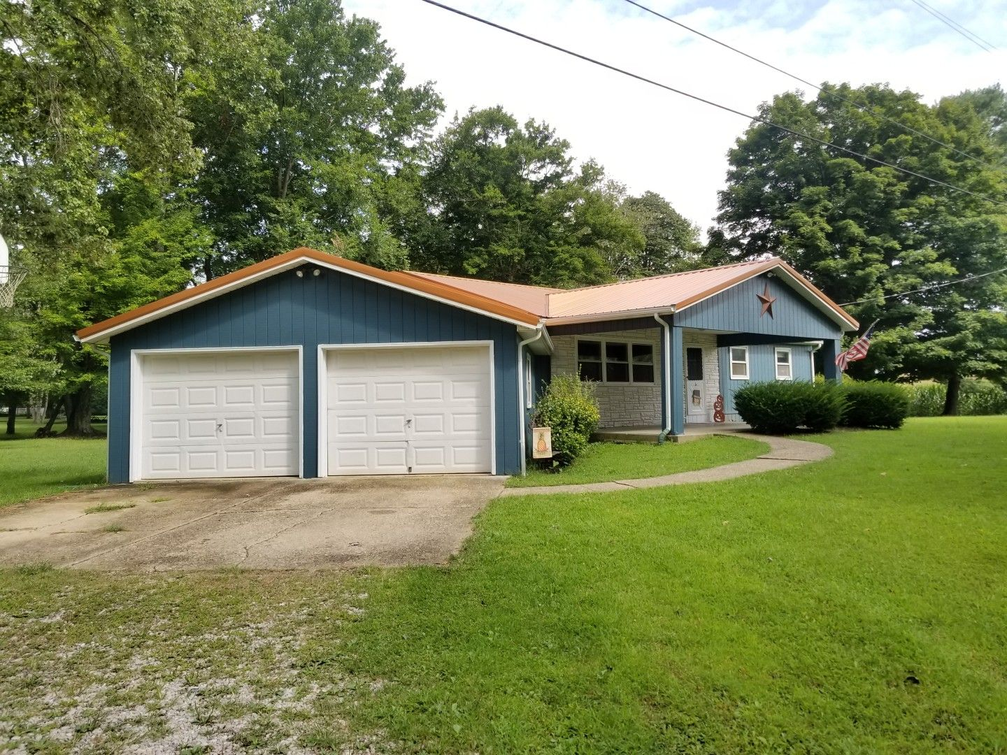 Best Blue House With Copper Metal Roof T1 11 Siding Copper 400 x 300