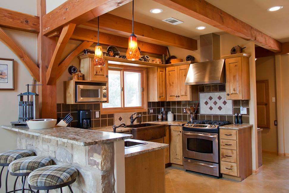 This small kitchen packs a punch on style doesn 39 t it by a member of tfbc timber frame homes for A frame house kitchen design