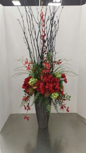 Red And Green Floral In Black Vase At Michaels In Longview
