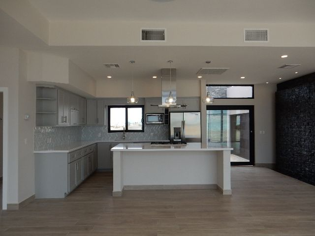 Best Spacious Kitchen In Grey And White With Stove And 400 x 300
