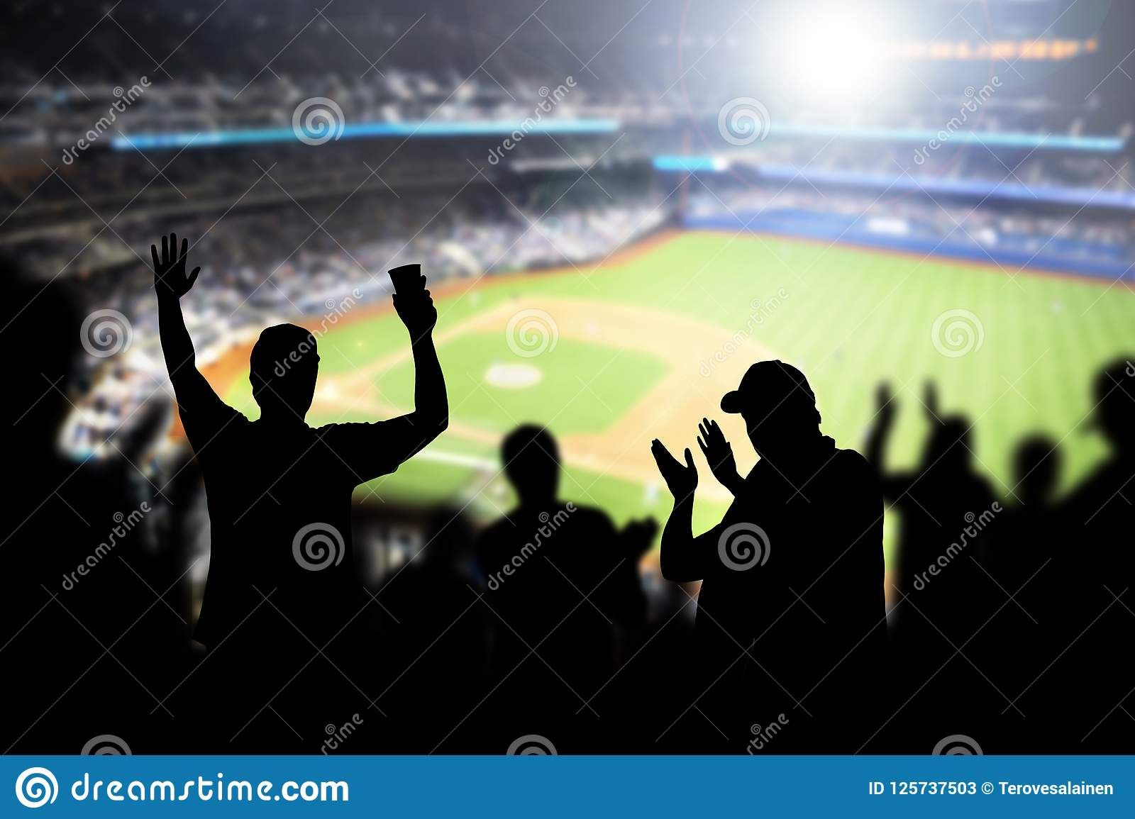 Baseball fans and crowd cheering in stadium and watching