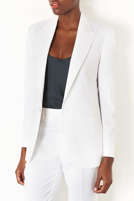 A white blazer adds a lot of sophistication to an outfit